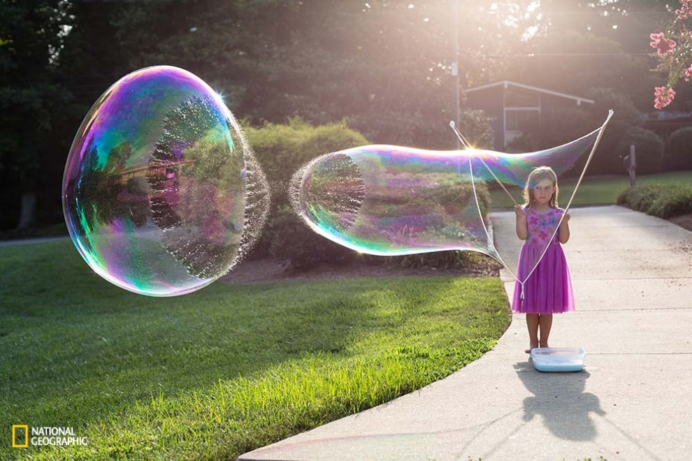 New favorite summer pastime . . . creating gigantic bubbles.  Making them is fun; but, watching them pop is fascinating!