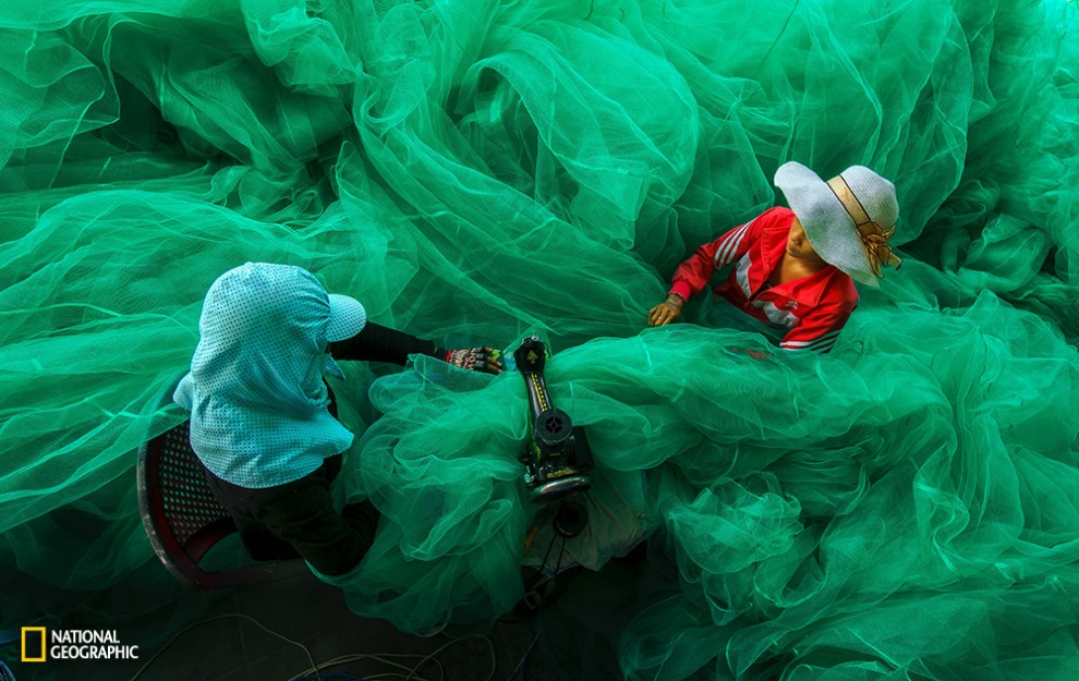 In Vinh Hy Bay, two women become lost in the fabric of a fishing net. That was just a random moment when I came to the fishing village to shoot the lifestyle of the fisherman. While the men do their fishing, their wives stay at home and do the errands. When we were there, the ladies were sewing the fishing net for a new fishing season.