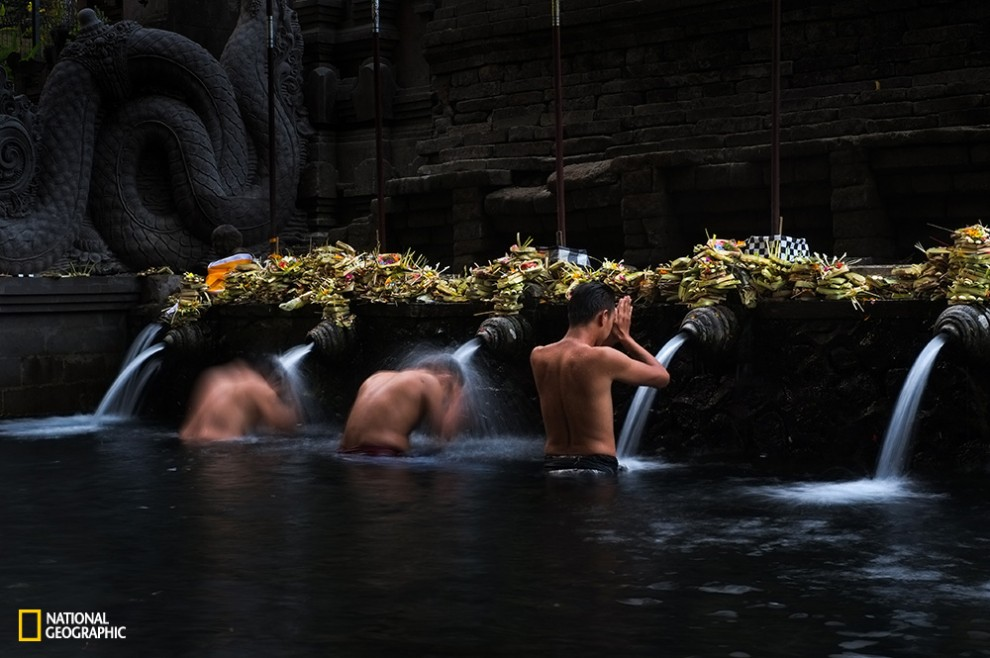 Bathing ritual taken place in one of the main temple in Bali, Tirta Empul Temple. Its fresh spring water is believed as holy water to purify the body and soul.