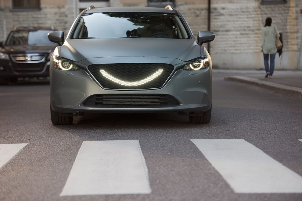 07-when-the-self-driving-cars-sensors-detect-a-pedestrian-a-smile-lights-up-at-the-front-of-the-car-and-the-car-stops