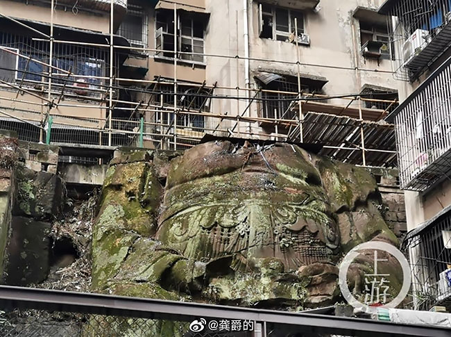 A Giant Headless Buddha Statue Discovered Under a Residential Complex in China