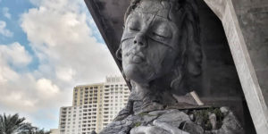 Giant Sculpture Of A Woman Opening Her Chest To Reveal A Fern-Covered Tunnel Appears In Florida